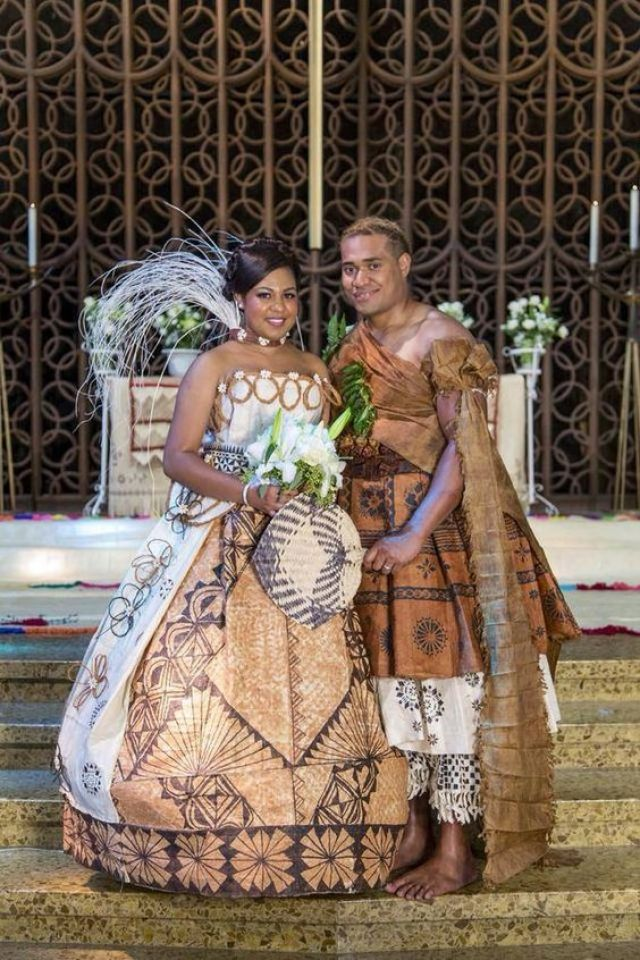 Eclectic mix of modern Fijian brides dress and traditional Fijian groom's attire