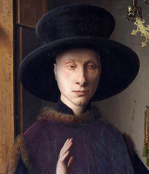 Hands: Giovanni Arnolfini looks to be blessing or making and oath. With his left hand holds his wife hand with authority. The wife's hand indicates submission.: