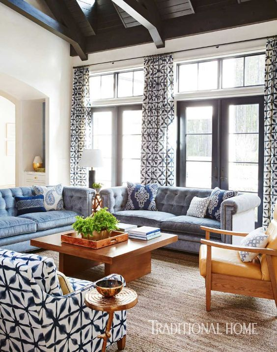 A Japanese-inspired, indigo-hue fabric used in draperies and as upholstery on a club chair is the starring print in the family room. - Photo: David A. Land / Design: Andrew Howard: