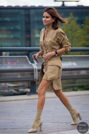 Christine Centenera in a khaki button-up + khaki mini skirt + grey suede ankle boots: