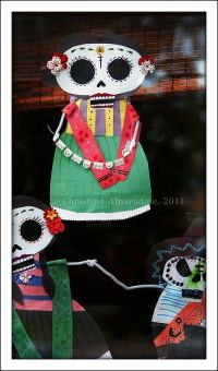 """Dia de los Muertos"" decorations we created for our front"