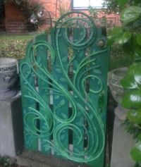 recycled water hose decorated garden gate... Gatescape