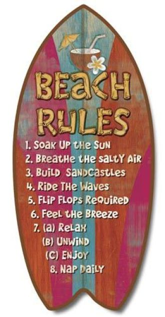 Beach rules written on surfboard
