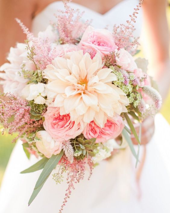 Next up on our lists of most memorable moments and details from this year on the #SouthernWeddings blog, we rounded up a few of the bouquets that stood out this year! Brittany's dahlia, astilbe, succulent, and rose bouquet by #BlueRibbonVendor @HollyChapple is at the top of our list--find more on #SouthernWeddings and let us know which one is your favorite! Photo by #BlueRibbonVendor @KatelynJames.: