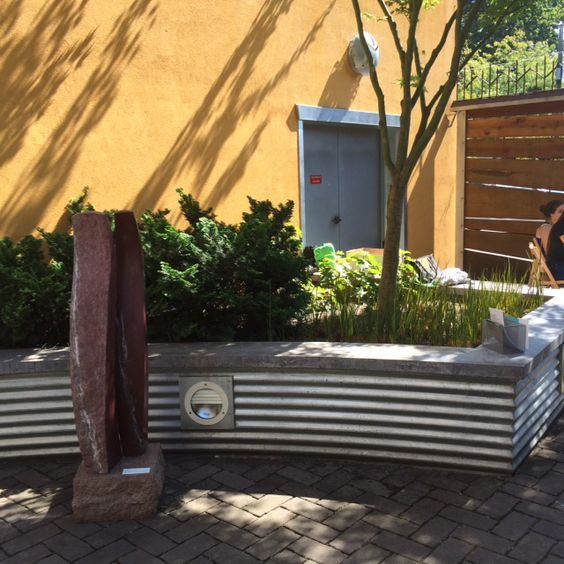 Corrugated Metal Retaining Wall With Concrete Top Layer