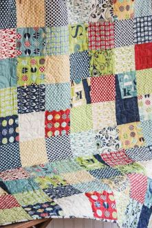 Too cute for words! This sweet baby quilt was pieced together with the gorgious fabric collection called Social Club designed by The Comstocks: