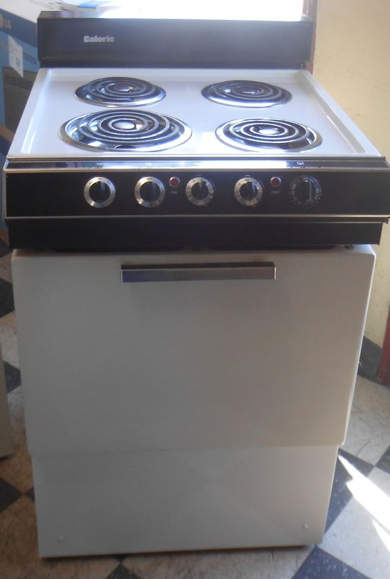 Appliance City  caloric 24 inch electric range 3 small burners 1 large white apartment size