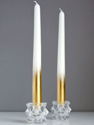 White tapers dazzle from top to bottom when enhanced with metallic paint. We think it's brilliant how Jeran of Oleander and Palm used gold spray paint to up the glam factor of everyday candles. Get all the details at Oleander and Palm.: