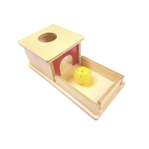 This activity gives the child practice with hand-eye co-ordination as the ball is put through the hole at the top. The ball then rolls in and out of sight giving a lesson in object permanence. The ball is then delivered to the front of the box ready to repeat the activity over and over.: