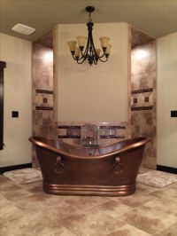 Rustic bathroom, hammered copper tub in front of a corner ...
