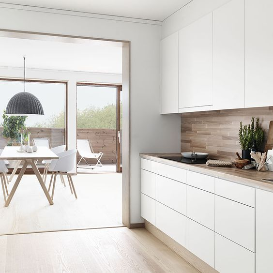 Cool detailing. Worktop wraps up as splashback,  skirting matches floor and cupboards extend to ceiling.: