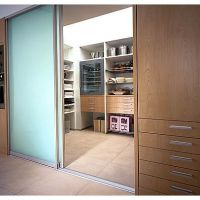 Modern walk-in pantry with opaque glass sliding doors ...