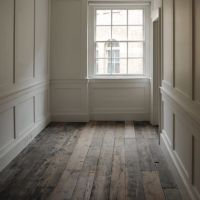rustic floors with traditional trim details to chair rail