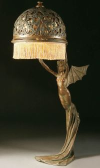 AN ART NOUVEAU BRONZED METAL FIGURAL TABLE LAMP probably