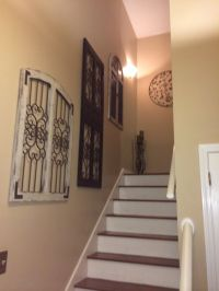 Vintage rustic window and door frames as stair wall decor