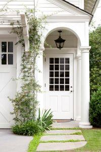 Carriage house entry porch  Trellis over garage doors ...