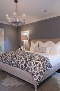 grey paint on the walls. white bedding. clean and simple ...