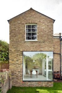 contemporary architecture, exposed bricks, Eames chairs ...