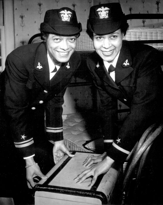 On Dec. 21, 1944, the first two African-American Navy WAVES officers complete their training. Lt. (jg) Harriet Ida Pickens and Ens. Frances Wills posing at their quarters at Naval Reserve Midshipmen's School, Northampton, Massachusetts. (US National Archives):