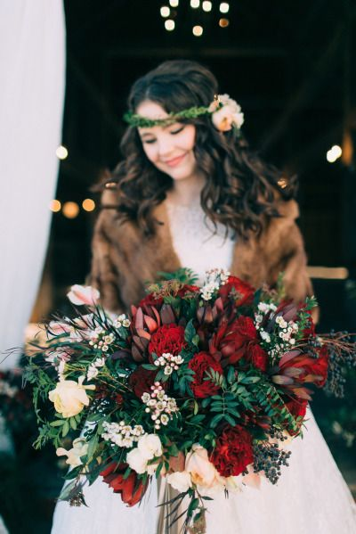 Richly hued red bouquet for Valentine's day: http://www.stylemepretty.com/2015/02/12/cozy-country-valentines-wedding-inspiration/ | Photography: Emily Delamater - http://emilydelamater.com/: