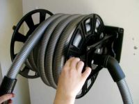 central vacuum hose storage
