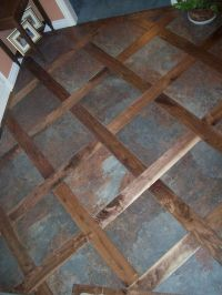 A custom tile & wood mixed floor. Good idea for ...