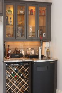 Custom wine rack in bar area with Kegerator and glass door ...