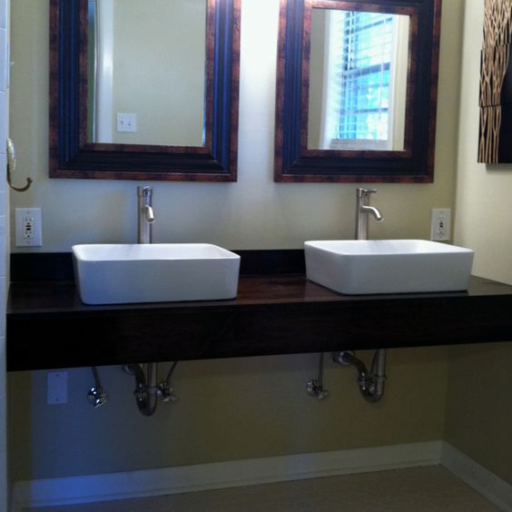 Master bath DIY floating vanity with vessel sinks.