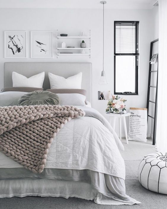 Gray is the new white! Love the way this color is paired with serene tones for a calming bedroom decor.: