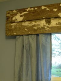 Reclaimed rustic wood as a window curtain valance. I love ...