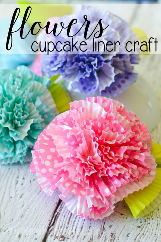 A fun little craft using cupcake liners, these flowers would make a great centerpiece for a spring brunch or to use as cute decor for a kids' room or craft room!: