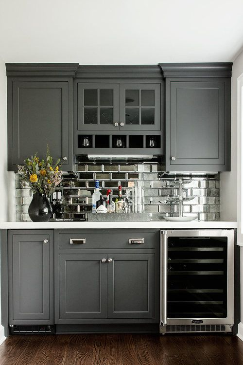 Dry Bar w/glass front mini fridge, mirrored subway tiles- great idea for remodel of outdated wet bar.l: