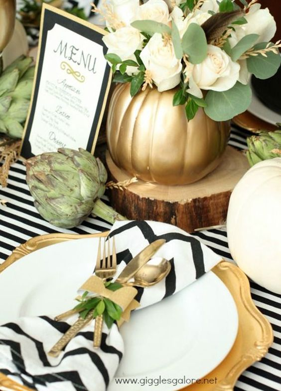 You can never go wrong with a little gold. Or a lot of it! Create a table color scheme of white, gold and black for an elegant palette that will never go out of style.: