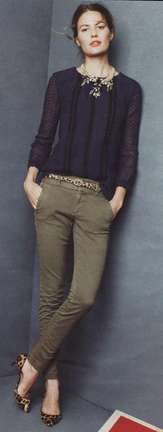 Dig the olive pants with black top, statement necklace & animal print shoes.: