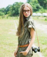 girl long brown hair glasses