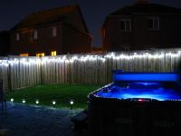 String lights along your fence for backyard lighting is