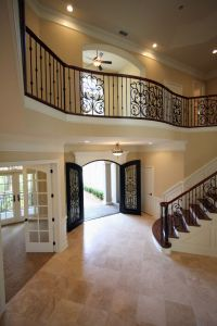 amazing open foyer with beautiful stair case and balcony ...