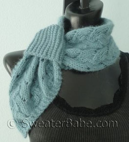 Pull-through Scarf knitting pattern in a pretty lace. Uses less than 200 yards of worsted weight yarn.: