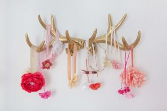 Gold Antlers for Holding Hair Bows - what a rustic, yet chic look in a baby girl nursery!: