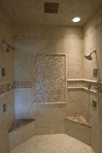 Walk-in tile shower with tile accents, a pebble floor, two ...