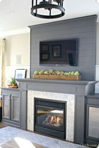 A DIY Gray Fireplace with Herringbone Tile