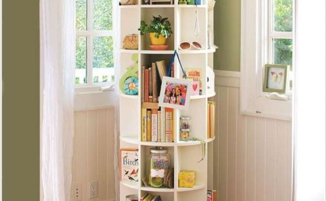 A Revolving Bookcase Loaded With Storage Space House