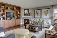 Corner gas fireplace & a built-in bookshelf makes this a ...