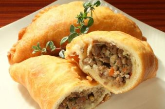 Irish Comfort: Handheld Meat #Pies. Handheld meat pies are a comforting Irish dish. Ground beef and pork are flavored with garlic, green onion, and red bell pepper. The filling is tucked into a homemade dough and deep fried. If you are short on time, you can make this recipe with pre-made pie dough and bake the pies instead of fry them. - Foodista.com:
