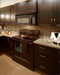 Modern kitchen with glass mosaic backsplash, taupe floor ...