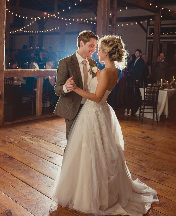 Bride & groom's first dance // Lauren Fair photography // http://blog.theknot.com/2013/12/16/a-cozy-and-glitzy-winter-wedding/: