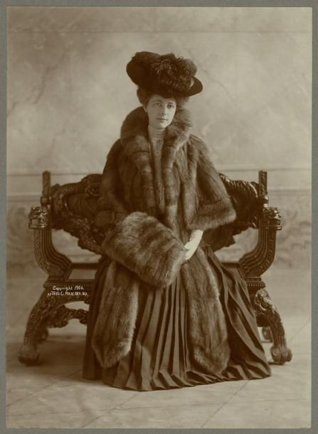 Woman wearing fur cape with fur muff, ca. 1906. New York Public Library: