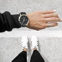 White nails + silver rings + gold and black watch. This ...