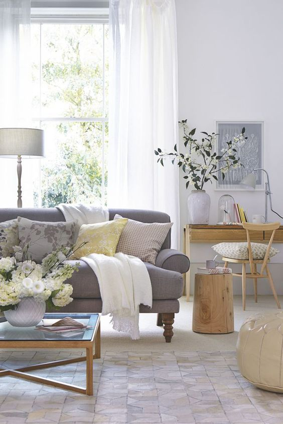 Living Room. Love the sofa....the shade of gray and the legs. Pillows make it all look inviting.: