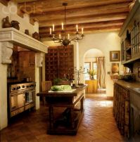 High end Spanish style kitchen with antique wood island ...